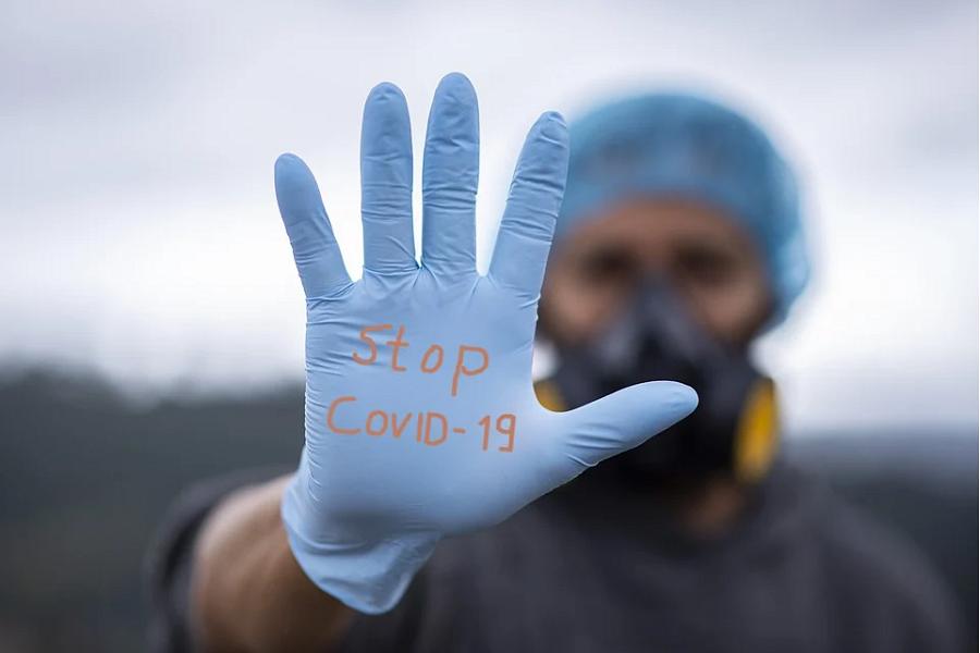 dłoń COVID-19 rękawiczka